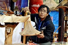 A Rahman poses with his unique wooden  and artefacts! Stalls, Wooden Furniture, Straw Bag, Poses, Unique, Bags, Timber Furniture, Figure Poses, Handbags