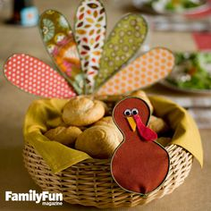 Well-Dressed Turkey Craft: This bird's fancy feathers are made from scraps of fabric and floral wire. Attach the plumage to a bread basket to create a functional centerpiece.