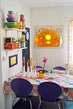 Patchwork table cloth. Pendant lampshade. Wood panelling. Blackboard. Love.