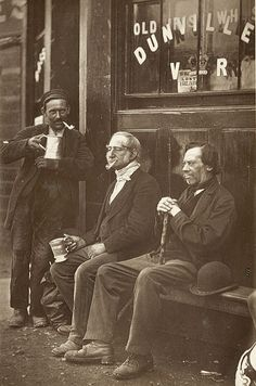 Men enjoying a drink outside a pub, London, 1877