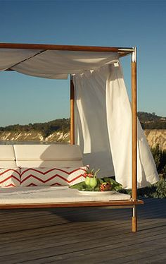 Antigua Canopied Daybed with Cushions.
