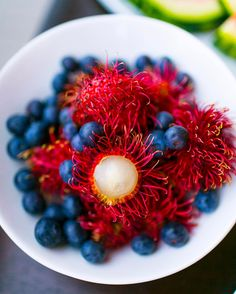 RAMBUTAN. ✨❤️✨ One of the world's most exotic tropical fruits and powerful healing foods! While red and alien-looking on the outside, it's clear jelly in the middle is incredibly sweet, flavorful, and healthy!! Related to the longan and lychee fruits, it is a complete source of carbs, fats, iron, phosphorus, calcium, and even vitamin C. It is rich in several minerals as well as flavonoids. Fruit truly is a powerful healing food! Who wants to try one?! ✨ #FullyRaw #hawaii #organic #Houston…