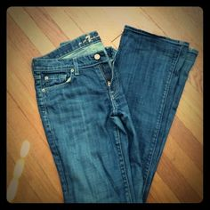 *24 HOUR SALE* Size 28, 7 for All Mankind jeans Perfect shade for day or night, go with everything. Slight flare, flattering for every figure. Small hole/worn area at back/bottom of legs. 7 for all Mankind Jeans