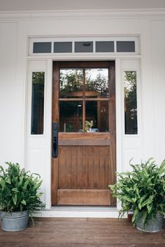20 Beautifully Clic Farmhouse Stained Wood Doors Table And Hearth Porch Plants Front Door