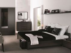 This Kaspian wenge bedroom set looks really masculine. Shop it now, the set includes a bed, a nightstand, a wardrobe, a mirror and a chest of drawers!