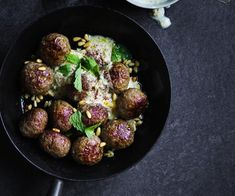Lamb meatballs with tahini and pine nut sauce recipe - To make meatballs, finely chop onion in a food processor, scraping down the sides occasionally (1-2 minutes), then add mince, garlic and spices, season to taste, and process until mixture comes together (30 seconds-1 minute).