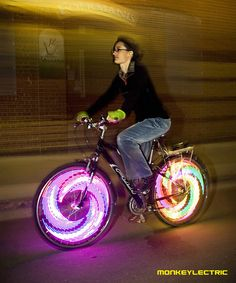 If you like to bike at night and want to make sure you'll always be seen by oncoming traffic then these LED Bike Wheel Lights are for you. Along with providing safety, they also look incredible with 32 full color LED lights that easily install into your e Pimp Your Bike, Bicycle Spokes, Glow Sticks, Burning Man, Led, Cool Gadgets, Light Up, Make Me Smile, Gifts For Kids