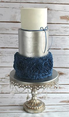 Navy Blue & Silver Wedding Cake on Antique Silver Chandelier Cake Stand by Opulent Treasures See more here: http://www.opulenttreasures.com/shop/chandelier-round-cakes-set-of-3