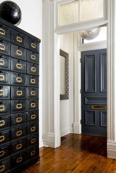 love this all! huge antique card catalog! amazing molding! transom window! AND is that a disco ball in the foyer???