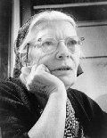 Dorothy Day (November 8, 1897 – November 29, 1980) was an American journalist, social activist, and devout Catholic convert; she advocated the Catholic economic theory of Distributism.  She was also considered to be an Anarchist, and did not hesitate to use the term.   A revered figure within the U.S. Catholic community, Day's cause for canonization is open in the Catholic Church.