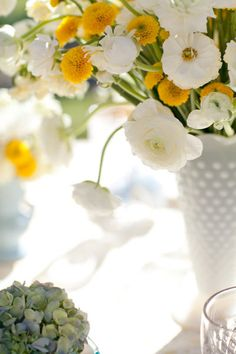 flowers with hobnail milk glass vase