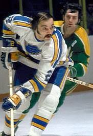 Steve Durbano of the Blues vs. Ivan Boldirev of the Seals. Nhl Players, St Louis Blues, Hockey Games, Vancouver Canucks, Long Live, Good Old, Seals, Note, History