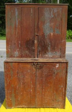19th Century two Piece Step back Cupboard - A New York State step back cupboard just the way you want to find these. Great old paint which is red over green over gray.