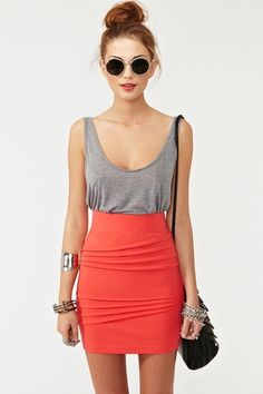 High waisted orange skirt, easy going gray tank, and hair in a bun. My style exactly