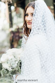 A polka-dotted veil is a fun way to infuse a touch of retro flair to your bridal ensemble, as evidenced by this beauty's Etsy accessory. #weddingideas #wedding #marthstewartwedding #weddingplanning #weddingchecklist Mullet Wedding Dresses, Chapel Length Veil, Vintage Veils, Amazing Wedding Dress, Wedding Veils, Bridal Headpieces, Bridal Gowns, Wedding Flowers, Nontraditional Wedding