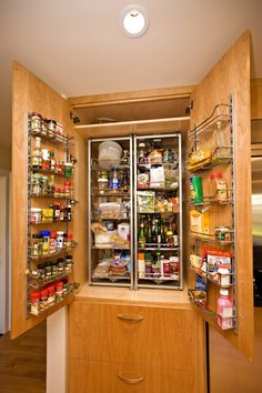 : Interesting Modern Kitchen With Modular Ceiling Lamp Above Wooden Pantry Cabinet With Drawer And Assorted Foods And Drink
