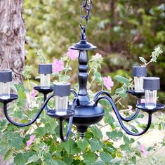 s 13 spectacular things to make for your yard using 1 solar lights, lighting, outdoor living, repurposing upcycling, This elegant updated chandelier #cheapoutdoorideas