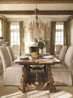 I love the farm house table meets elegant dining room look.