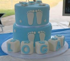 A boy blue and white birthday cake at a naming nceremony