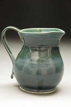 Wide bellied jug with a curved handle. White stoneware fired to cone 6 Available for purchase Stoneware, Handle, Pottery, Sculpture, Ceramica, Pottery Marks, Sculptures, Ceramic Pottery, Sculpting