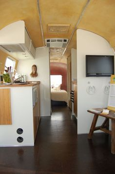 Glue down cork flooring is great in travel trailors and campers. Light-weight, flexible, warm, sound absorbing, and easy to maintain. Perfect!     Livingreen remodel of a vintage Airstream: cork floor tiles, bamboo counters and cabinets, earth plaster walls.