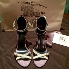 BURBERRY Prorsum Stiletto Heels Price reduced Double ankle & toes adjustable straps (fit size 6 too) 100% authentic. Leather with covered areas of burberry signature material. These sandals are so beautiful and due to their material can be worn during the fall with jackets or a trench coat (straps are the same color as the burberry signature trench coat). Only worn once indoors has circular mark in 1 sole because were on display (very small unnoticeable flaw on inner strap). Made in Italy…