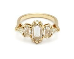 The aptly named Theda Ring is a truly splendorous piece evocative of it's namesake, a star of the Silent Film Era. The layout of the five diamonds in this design call to mind the gilded cinemas in which her silent films were screened, and an elongated rose cut diamond center is reminiscent of the the marquees that announced them.