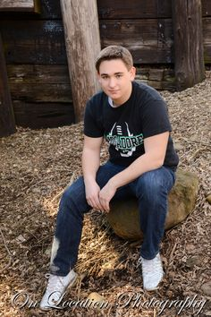 Posing in neutral areas brings the eye to this high school senior male. Just a hint of smile completes this image.