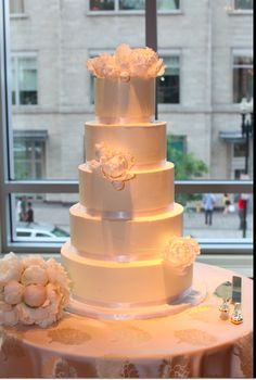Wedding cake! By Cakes to Remember in Brookline, Mass. Totally fondant-free with gumpaste peonies. (my toss bouquet with real peonies is on the table) - As Seen in the 2011 issue of Southern New England Weddings