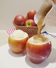 Vanilla ice cream and caramel inside an apple cup.