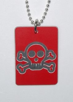 Plastic Skull & Cross Bones Tag.  This hardened plastic Skull & Cross Bones Tag is designed for those who love their pirates or enjoy pretending they are one. This tag is 26mm x 36mm (slight deviations to these measurements may occur due to each tag being individually handcrafted). This tag can be made in a variety of colours and any custom engraving to personalise the back of your tag is FREE.