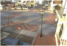 Pavement treatments can be applied to the entire traffic–calmed area or limited to specific street uses.
