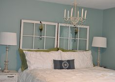 Old windows as a 'headboard'. I also love how soothing this master bedroom feels.