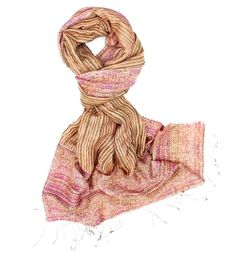 If you've caught the fall craze, here are 15 scarves made by artisans all  over the world who were paid a fare wage for their work. Every scarf tells  a story and these stories are ones of resilience and artisanship.