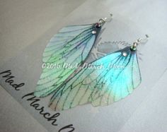 Dragon wing earrings iridescent with sterling silver ear
