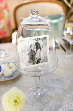 Centrepiece idea: a black and white photo of the bride and groom under a cloche jar. Sweet!