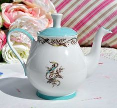 Vintage small teapot with turquoise glaze