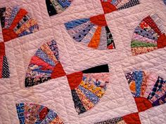 fan quilt - cute setting and colors. Looks like a mini quilt.