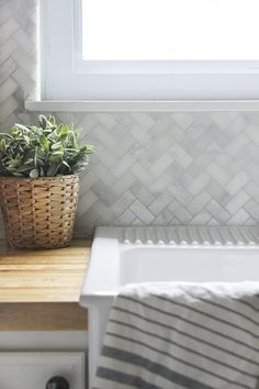 How to install kitchen tile backsplash including tips on how much tile to buy, how to cut around outlets and windows, and the best type of grout to use.