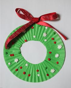How to make a super easy cupcake liner wreath. Perfect Christmas kids craft!
