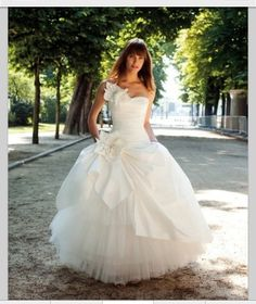 Taffeta and Tulle Strapless Sweetheart Neckline Soft Rouched Bodice with Floral Embellishment Accents Ball Gown Style