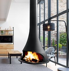 Modern fireplace: find a modern fireplace in our collection, heat and decorate your living room with a modern fireplace. Find a modern fireplace or a free standing wood stove among the large range of JC Bordelet contemporary fireplaces and stoves.