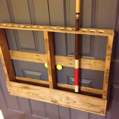Small pallet, box panels at the bottom, jigsaw holes on top. Hang under Billy Bass wall. Pool Table Sticks, Pallet Pool, Pool Table Room, Patio Tiles, Diy Pool, Pool Cues, Palette, Pallet Creations, Wood Pallets