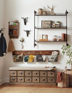 Create a storage station in your home with wall shelves and a storage bench. This is the perfect solution for a small space that needs a little decluttering. HomeDecorators.com #storage