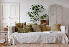 THE SLOW APPROACH TO CRAFTING A HOME natural home decor neutral home decor colours neutral interior palette home decorating with natural materials linen sofa cover muted green velvet cushion covers olive green velvet cushion covers White Home Decor, Natural Home Decor, Moving Furniture, Plywood Furniture, Sofa Covers, Cushion Covers, Slow Living, White Houses, Colorful Decor