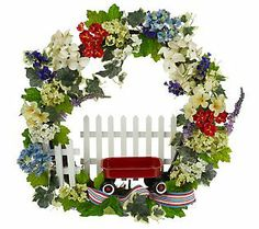 What a cute summer wreath by Valerie Parr Hill.  :)