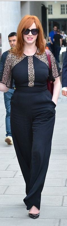 d3703b0cd087 Christina Hendricks  Jumpsuit – Temperley London Sunglasses – Karen Walker  Black Lace Jumpsuit