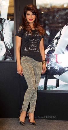 Priyanka Chopra showed off her curves in printed skinnys, a black tee shirt and spiked Louboutins at an event for GUESS. #Bollywood #Fashion #Style #Beauty