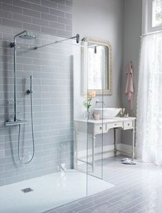 Glass shower doors will make your bathroom look bigger and less cluttered, by eliminating visual barriers.