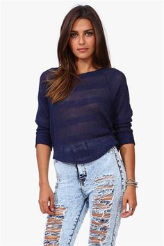 A cute navy loose knit sweater that has a baggy fit and would look adorable paired with a mini skater skirt and high top sneakers.